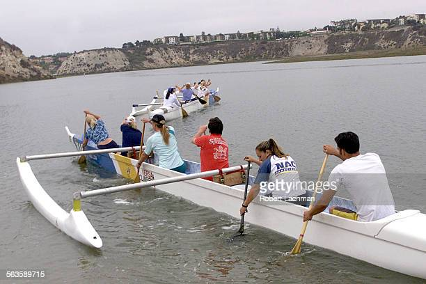 Members of the Newport Aquatic Center woman's outrigger canoe team along with coaches practice in the Upper Newport Bay