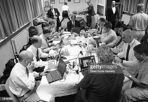 Members of the news media file stories and photographs of US President George W Bush's visit to NATO headquarters June 25 2001 in Brussels Belgium