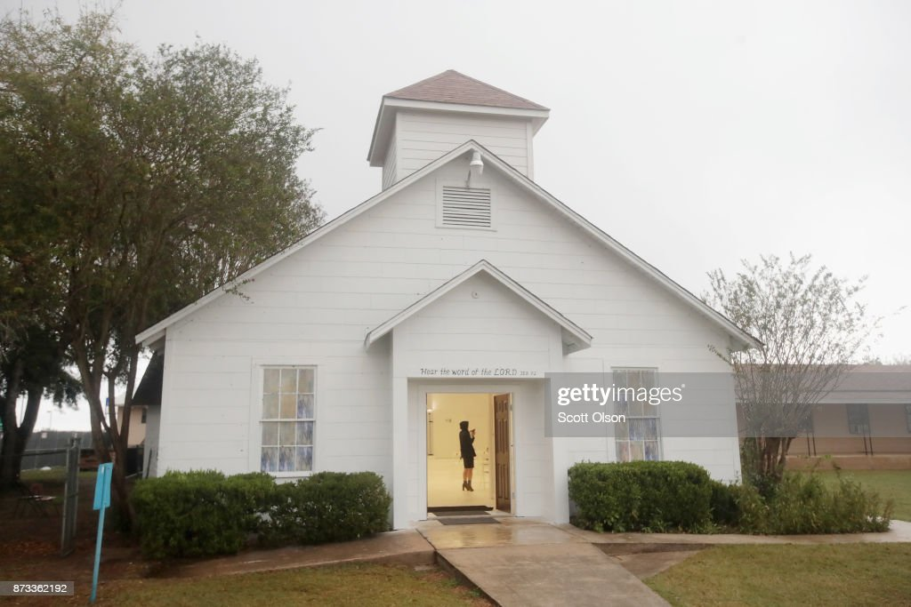 Members of the news media tour the First Baptist Church of Sutherland Springs which has been turned into a memorial to honor those who died on November 12, 2017 in Sutherland Springs, Texas. The inside of the church has been painted white with 26 white chairs placed around the room. On each chair is a single rose and the name of a shooting victim. The chairs are placed throughout the room at the location where the victim died. The memorial will be open to the public. Devin Patrick Kelley shot and killed the 26 people and wounded 20 others when he opened fire during Sunday service at the church on November 5th.
