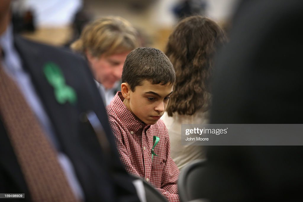 Members of the Newtown community attend a press conference with parents of Sandy Hook Elementary victims on January 14, 2013 in Newtown, Connecticut. Eleven families of Sandy Hook massacre victims came to the event one month after the shooting to give their support to Sandy Hook Promise, a new non-profit with the goal of preventing such tragedies in the future.