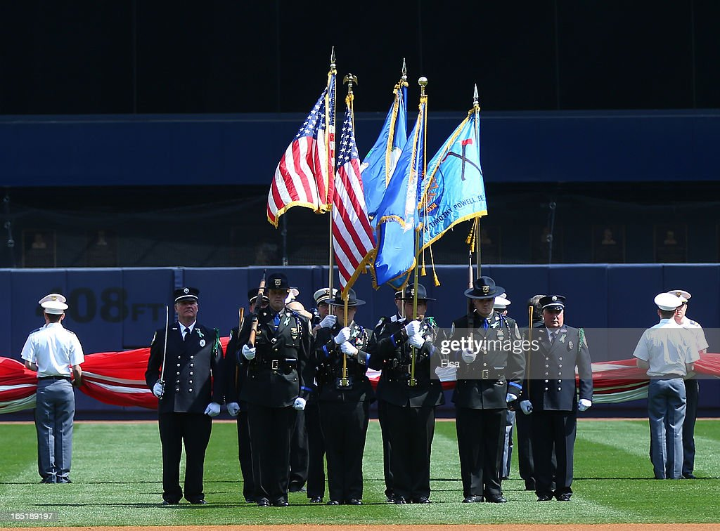 Members of the Newtown, Connecticut first responders serve as the color guard as the national anthem is played before the game between the New York Yankees and the Boston Red Sox before Opening Day on April 1, 2013 at Yankee Stadium in the Bronx borough of New York City.