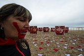 Members of the NGO Rio de Paz hold a demonstration against violence against women displaying some 420 panties and portraits of bloodstained women in...