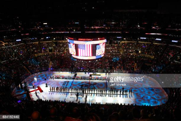 Members of the NHL 100 and the 2017 NHL AllStars line up on the ice during the singing of the US National anthem prior to the 2017 Honda NHL AllStar...