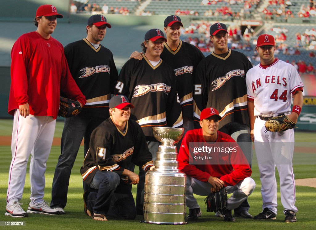Members of the NHL Stanley Cup-winning Anaheim Ducks, second left, <a gi-track='captionPersonalityLinkClicked' href=/galleries/search?phrase=Dustin+Penner&family=editorial&specificpeople=589919 ng-click='$event.stopPropagation()'>Dustin Penner</a>, <a gi-track='captionPersonalityLinkClicked' href=/galleries/search?phrase=Chris+Kunitz&family=editorial&specificpeople=604159 ng-click='$event.stopPropagation()'>Chris Kunitz</a>, kneeling, <a gi-track='captionPersonalityLinkClicked' href=/galleries/search?phrase=Brad+May&family=editorial&specificpeople=212874 ng-click='$event.stopPropagation()'>Brad May</a>, <a gi-track='captionPersonalityLinkClicked' href=/galleries/search?phrase=Chris+Pronger&family=editorial&specificpeople=204521 ng-click='$event.stopPropagation()'>Chris Pronger</a> and <a gi-track='captionPersonalityLinkClicked' href=/galleries/search?phrase=Ryan+Getzlaf&family=editorial&specificpeople=602655 ng-click='$event.stopPropagation()'>Ryan Getzlaf</a> pose with Los Angeles Angels pitchers <a gi-track='captionPersonalityLinkClicked' href=/galleries/search?phrase=John+Lackey&family=editorial&specificpeople=171533 ng-click='$event.stopPropagation()'>John Lackey</a>, left, and Scot Shields, third right kneeling, and catcher and <a gi-track='captionPersonalityLinkClicked' href=/galleries/search?phrase=Mike+Napoli&family=editorial&specificpeople=525007 ng-click='$event.stopPropagation()'>Mike Napoli</a> before the Angels' interleague baseball game against the Houston Astros in Anaheim, California on June 19, 2007.