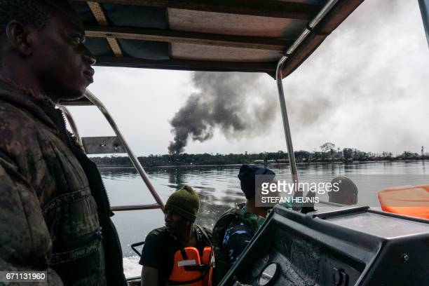 TOPSHOT Members of the NNS Pathfinder of the Nigerian Navy forces are out on patrol looking for illegal oil refineries on April 19 2017 in the Niger...
