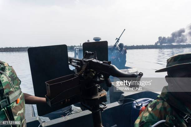 Members of the NNS Pathfinder of the Nigerian Navy forces goes out on patrol looking for illegal oil refineries on April 19 2017 in the Niger Delta...