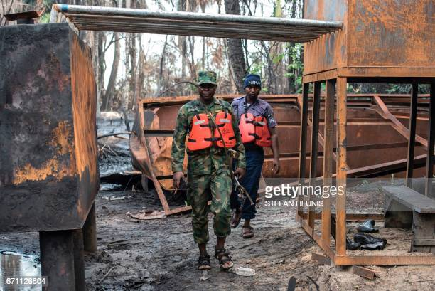 Members of the NNS Pathfinder of the Nigerian Navy forces inspect a destroyed illegal oil refinery was on April 19 2017 in the Niger Delta region...