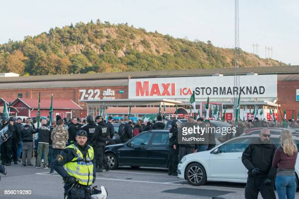 Members of the Nordic Resistance Movement walk back to their cars after failing to complete their march through central Gothenburg Sweden on...