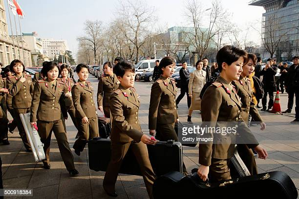 Members of the North Korean female music group Moranbong Band leave the hotel for concert rehearsal on December 11 2015 in Beijing China The...