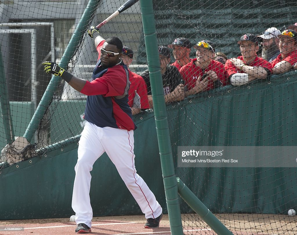 Members of the Northeastern University Huskies watch as David Ortiz #34 of the Boston Red Sox takes batting practice before an exhibition game at jetBlue Park on February 27, 2013 in Ft. Myers, FL.
