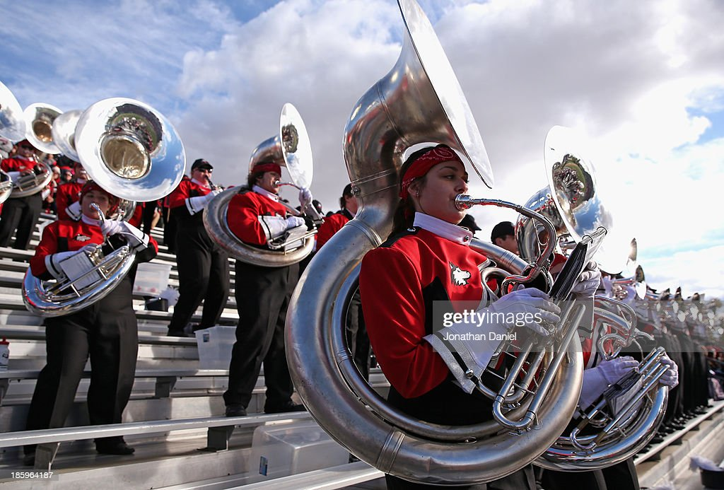 Members of the Northern Illinois Huskies band peform during a game between the Huskies and the Eastern Michigan Eagles at Brigham Field on October 26, 2013 in DeKalb, Illinois. Northern Illinois defeated Eastern Michigan 59-20.