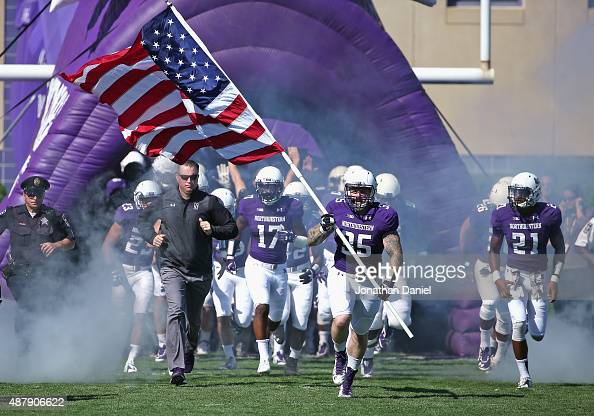 Members of the Northwestern Wildcats run onto the field before a agem against the Eastern Illinois Panthers at Ryan Field on September 12 2015 in...