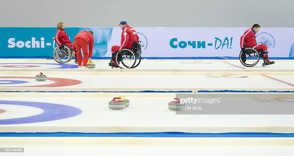 Members of the Norwegian Wheelchair Curling team take part in a test event at the Olympic Curling Centre in Adler, Russia on February 21, 2013. With a year to go until the Sochi 2014 Winter Games, construction work continues as tests events and World Championship competitions are underway.