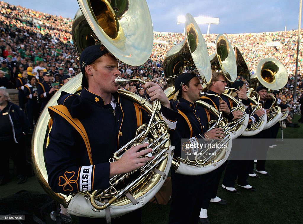Members of the Notre Dame Fighting Irish band tuba section play during a game against the Michigan State Spartans at Notre Dame Stadium on September 21, 2013 in South Bend, Indiana. Notre Dame defeated Michigan State 17-13.