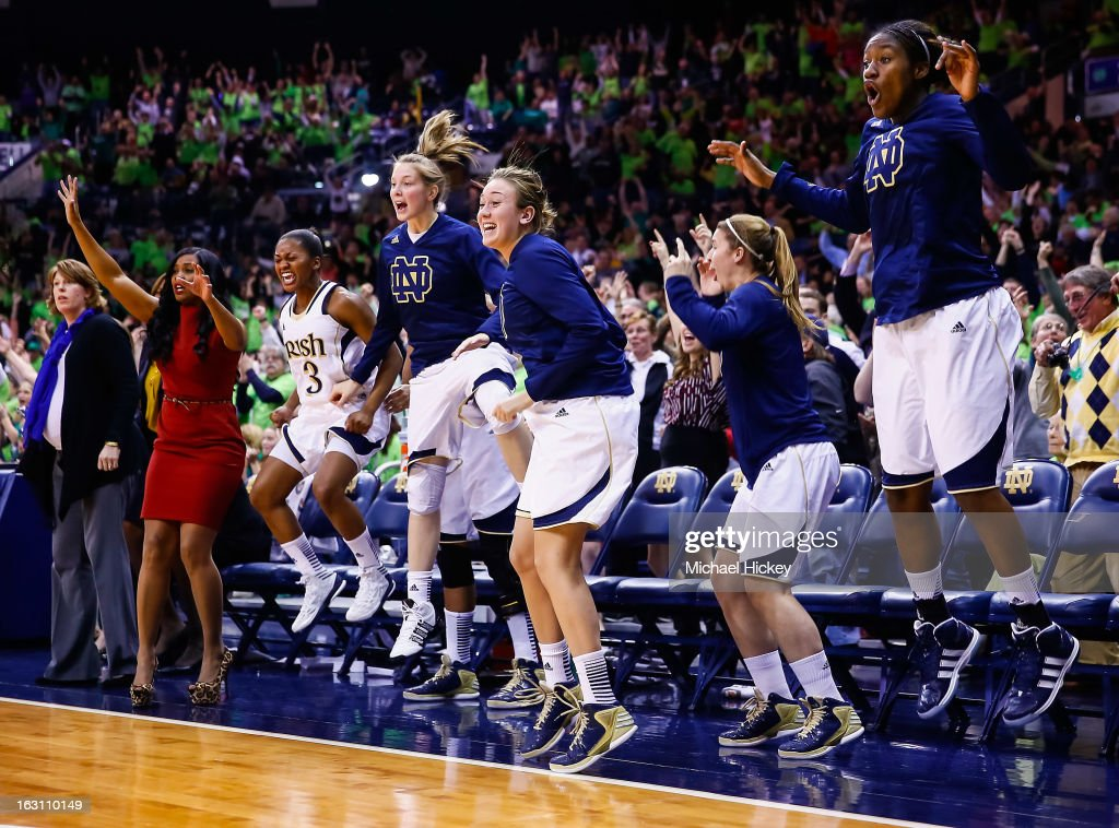 Members of the Notre Dame Fighting Irish celebrate in the closing minutes against the Connecticut Huskies at Purcel Pavilion on March 4, 2013 in South Bend, Indiana. Notre Dame defeated Connecticut 96-87 in triple overtime to win the Big East regular season title.