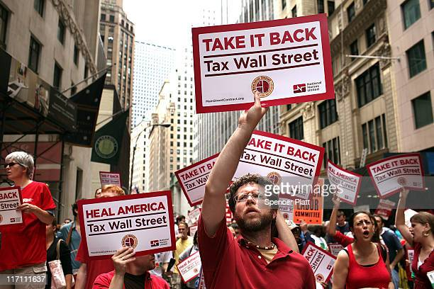 Members of the nurses union National Nurses United and other workers converge on Wall Street to protest against financial intuitions and inequality...