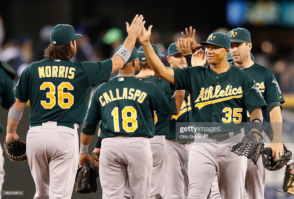 Members of the Oakland Athletics celebrate after defeating the Seattle Mariners 9-0 at Safeco Field on September 29, 2013 in Seattle, Washington.