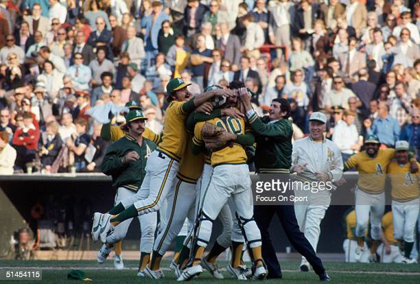 Members of the Oakland Athletics celebrate after winning Game 7 of the 1973 World Series against the New York Mets on October 21 1973 at...