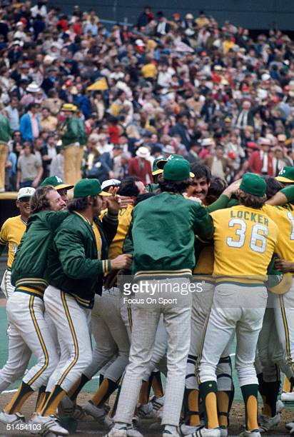 Members of the Oakland Athletics celebrate on the field after winning Game 7 of the 1973 World Series against the New York Mets on October 21 1973 at...