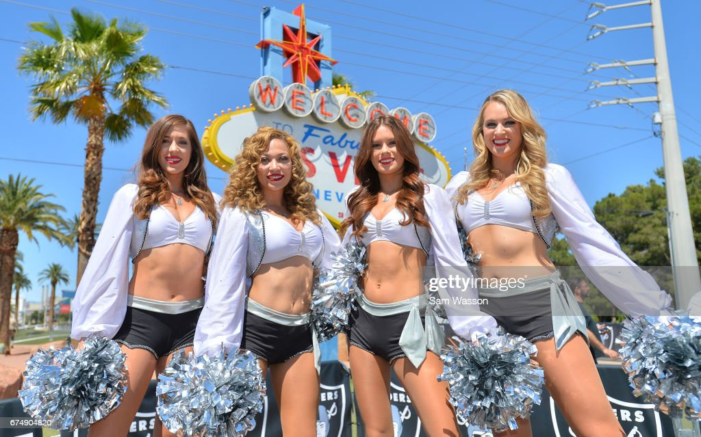 Members of the Oakland Raiderettes cheer team pose for a photo during the team's 2017 NFL Draft event at the Welcome to Fabulous Las Vegas sign on April 29, 2017 in Las Vegas, Nevada. National Football League owners voted in March to approve the team's application to relocate to Las Vegas. The Raiders are expected to begin play no later than 2020 in a planned 65,000-seat domed stadium to be built in Las Vegas at a cost of about USD 1.9 billion.