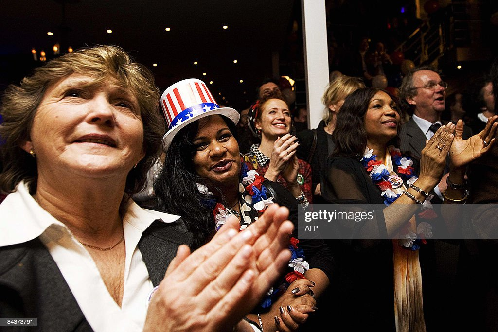 Members of the 'Obamaclub', the Dutch fanclub of Barack Obama, celebrate during the inauguration ceremonny of US President Barack Obama in a restaurant in the Hague on Jauary 20, 2009. Barack Obama took the oath of office to become the first black president in US history today, proclaiming America had chosen 'hope over fear' and must unite in a 'new era of responsibility' to triumph over its multiple crises. AFP PHOTO/ANP/VALERIE KUYPERS ---netherlands out - belgium out---