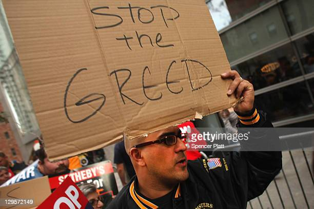 Members of the Occupy Wall Street community join Teamsters in front of the auction house Sotheby's to protest the lockout of union art handlers in a...