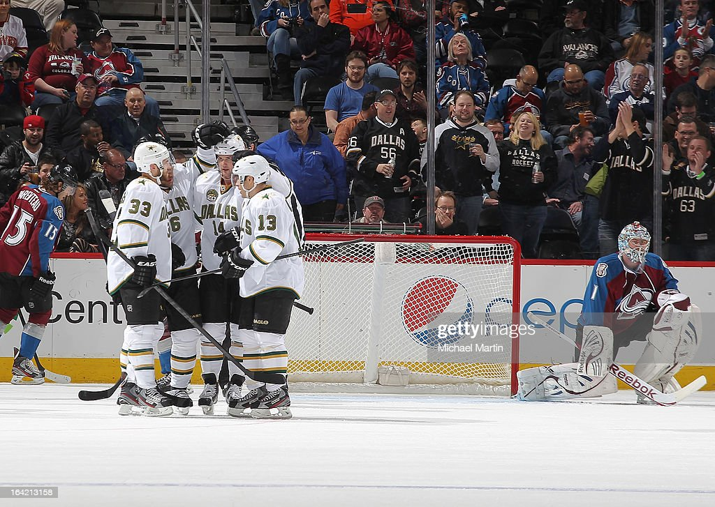 Members of the of the Dallas Stars celebrate a goal against the Colorado Avalanche at the Pepsi Center on March 20, 2013 in Denver, Colorado.