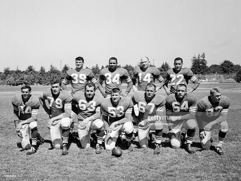 Members of the offense for the San Francisco 49ers pose for a team portrait prior to a training camp workout in August 1954 in Santa Clara California...