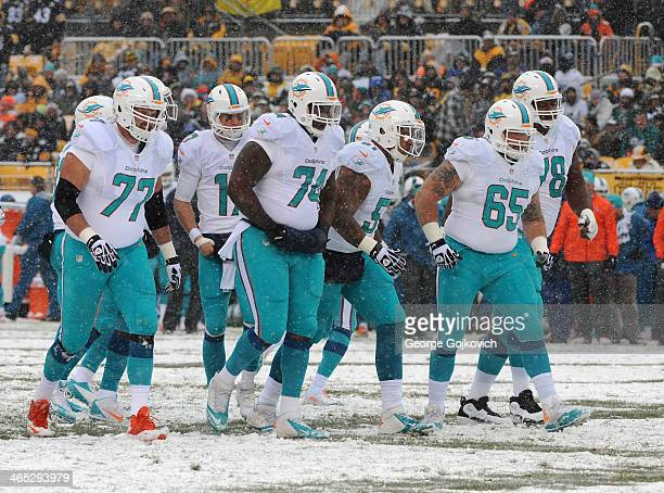 Members of the offensive line of the Miami Dolphins including tackles Tyson Clabo and Bryant McKinnie guards John Jerry and Sam Brenner and center...