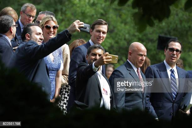 Members of the official Lebanese delegation and journalists pose for selfies with President Donald Trump's daughter Ivanka Trump and her husband...