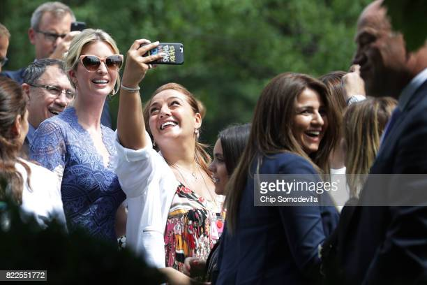 Members of the official Lebanese delegation and journalists pose for selfies with President Donald Trump's daughter Ivanka Trump as they wait for the...