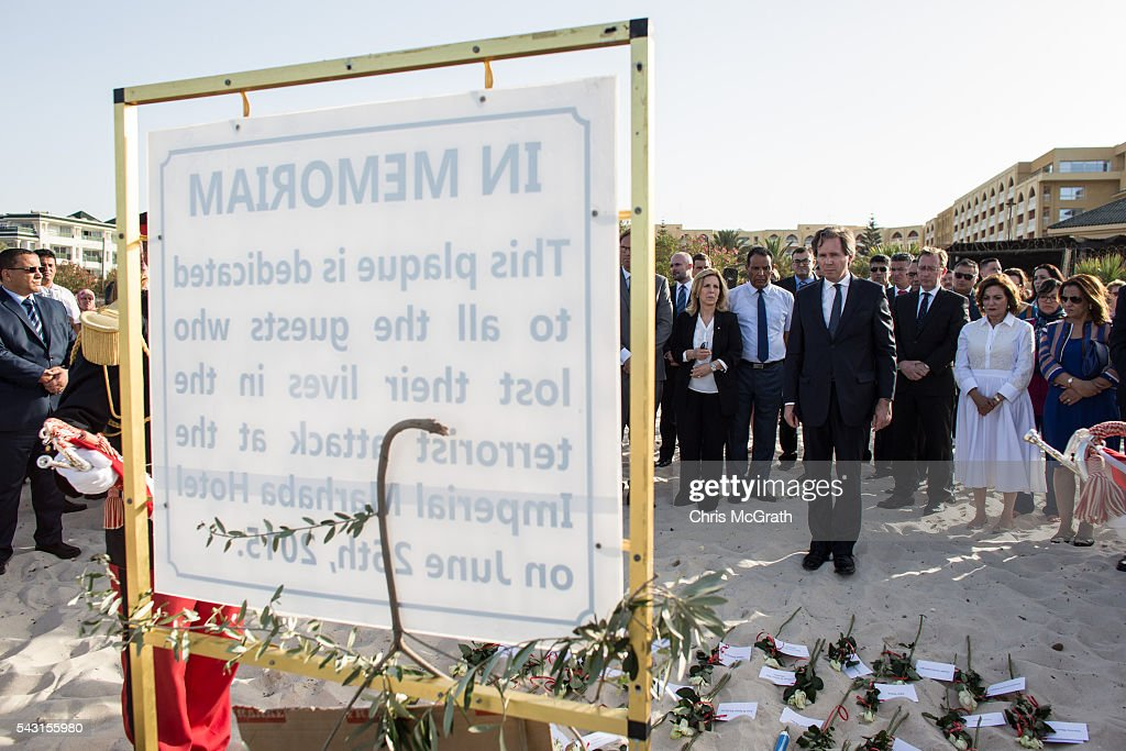 Members of the official party pay their respects to the victims of the 2015 Sousse Beach terrorist attack during a memorial service on the beach in front of the Imperial Marhaba hotel on June 26, 2016 in Sousse, Tunisia. Today marks the one year anniversary of the Sousse Beach terrorist attack, which killed 38 people including 30 Britons. Before the 2011 revolution, tourism in Tunisia accounted for approximately 7% of the countries GDP. The two 2015 terrorist attacks at the Bardo Museum and Sousse Beach saw tourism numbers plummet even further forcing hotels to close and many tourism and hospitality workers to lose their jobs.