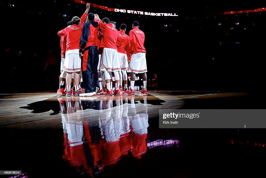 Members of the Ohio State Buckeyes huddle up prior to the start of the game against the Iowa Hawkeyes at Value City Arena on December 30 2014 in...