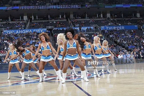 Members of the Oklahoma City Thunder Girls perform during a break in the action against CSKA Moscow on October 14 2010 at the Ford Center in Oklahoma...