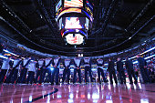 Members of the Oklahoma City Thunder stand during the national anthem prior to a game against the New Orleans Pelicans at the Smoothie King Center on...