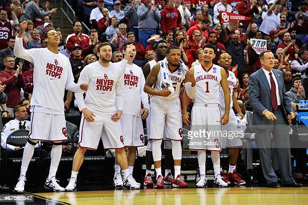 Members of the Oklahoma Sooners bench celebrate against the Albany Great Danes during the first half of the second round of the 2015 NCAA Men's...