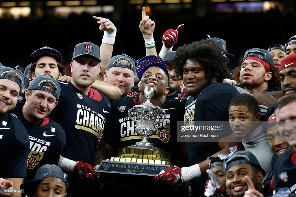 Members of the Oklahoma Sooners celebrate after defeating the Auburn Tigers 35-19 during the Allstate Sugar Bowl at the Mercedes-Benz Superdome on January 2, 2017 in New Orleans, Louisiana.