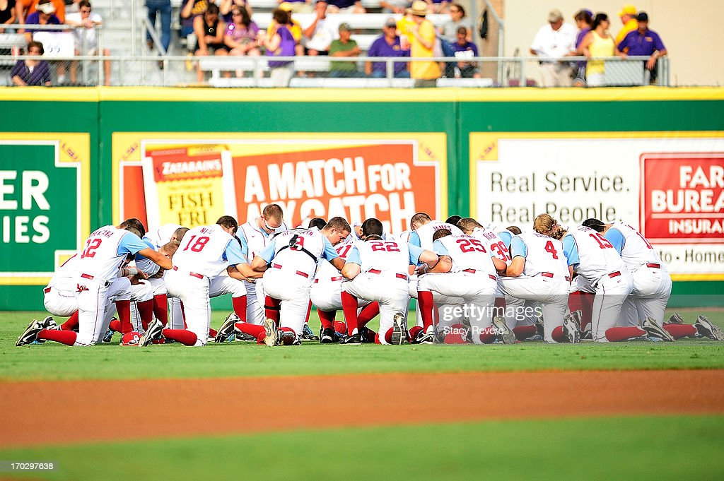 Members of the Oklahoma Sooners gather in the outfield prior to game 2 of the NCAA baseball Super Regionals against the LSU Tigers at Alex Box Stadium on June 8, 2013 in Baton Rouge, Louisiana.