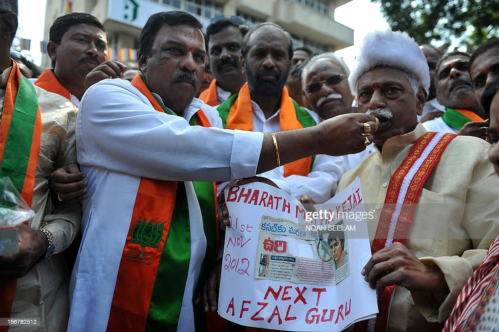 Members of the opposition Bharatiya Janata Party distribute sweets as they celebrate the execution of Pakistanborn Mohammed Kasab the sole surviving...