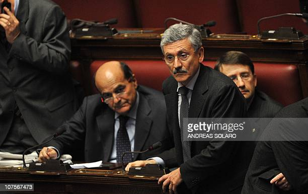 Members of the opposition Democratic Party leader Pier Luigi Bersani and deputy Massimo D'Alema attend a session for a confidence vote at the Chamber...