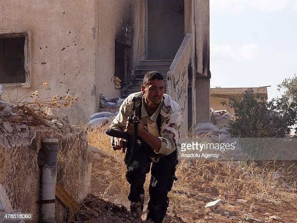 Members of the opposition forces attack to the areas under the control of Syrian regime forces on June 25 2015 in Daraa Syria