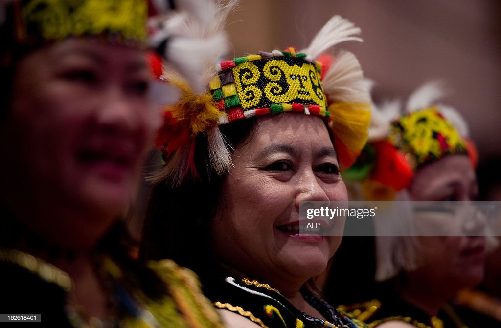 Members of the opposition party wearing Sarawak's Bidayuh costumes listen to their leader Anwar Ibrahim speak during the launch of the party's election manifesto at the Shah Alam Convention Centre in Shah Alam on February 25, 2013. Malaysia's opposition unveiled a sweeping election manifesto on February 25 that pledges to eliminate authoritarian rule and corruption, while promising lower fuel prices and other populist sweeteners. AFP PHOTO / MOHD RASFAN