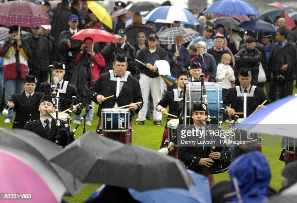 Members of the Oran Mor Pipeband perform during the World Pipe Band Championships in Glasgow