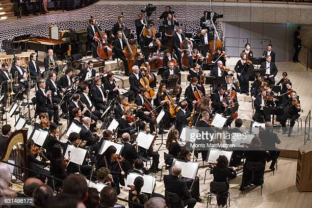 Members of the orchestra tune thier instruments before the opening concert of the Elbphilharmonie concert hall on January 11 2017 in Hamburg Germany...