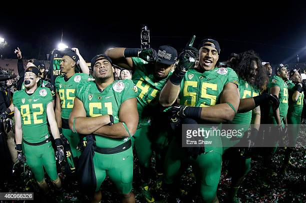 Members of the Oregon Ducks celebrate after defeating the Florida State Seminoles 5920 in the College Football Playoff Semifinal at the Rose Bowl...