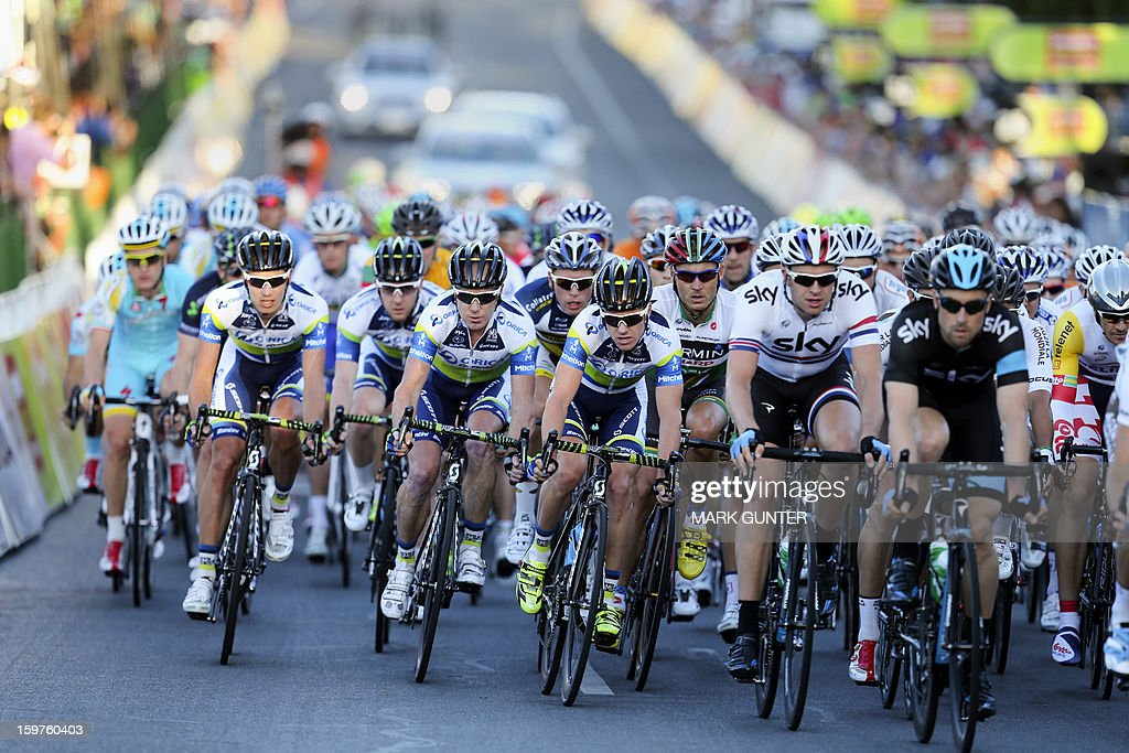 Members of the Orica-GreenEdge team (C) from Australia race during the 51km People's Choice Classic prior to the Tour Down Under in Adelaide on January 20, 2013. The six-stage Tour Down Under takes place from January 20 to 27. AFP PHOTO / Mark Gunter USE