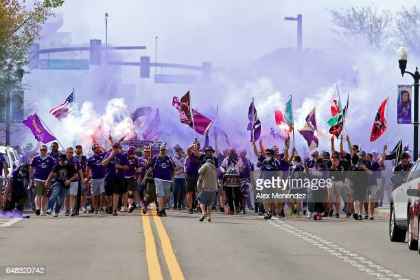 Members of the Orlando Ruckus march to the stadium prior to a MLS soccer match between New York City FC and Orlando City SC at the Orlando City...