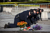 Members of the Ottawa Police sweep the area in front of the National War Memorial one day after a lone gunman killed Cpl Nathan Cirillo of the...