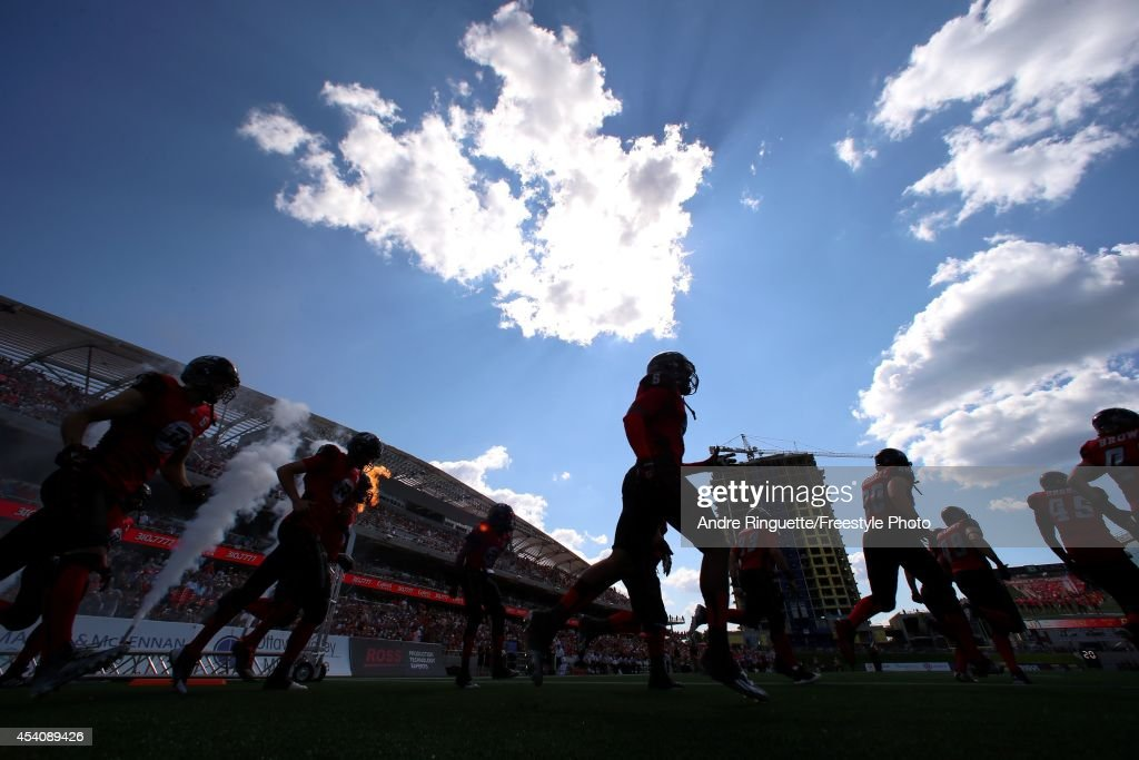 Members of the Ottawa Redblacks take to the field during player introductions prior to playing a CFL game against the Calgary Stampeders at TD Place Stadium on August 24, 2014 in Ottawa, Ontario, Canada.