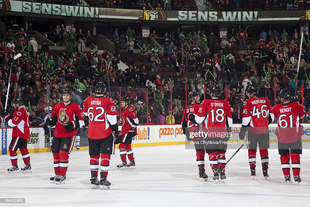 Members of the Ottawa Senators acknowledge the fans after a win during an NHL game against the Winnipeg Jets at Scotiabank Place on March 17, 2013 in Ottawa, Ontario, Canada.